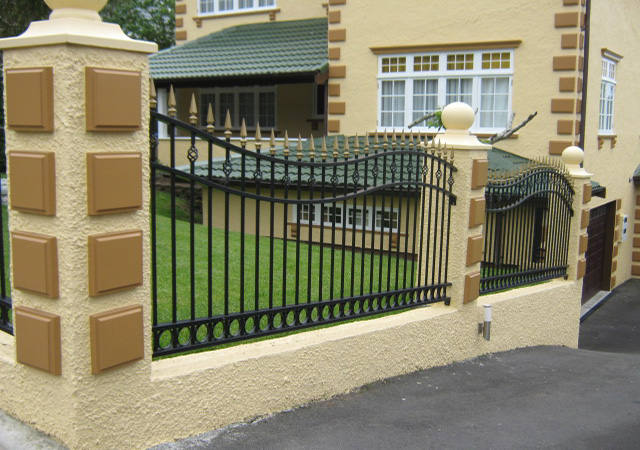 Concrete work and wrought iron fence panels.
